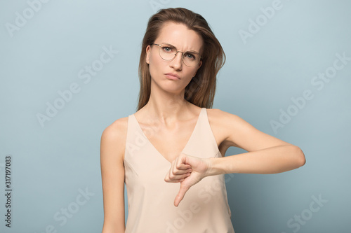 Disappointed woman in glasses show thumb down feel dissatisfied Canvas Print