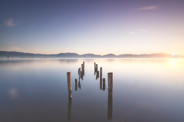 Panel Szklany Molo Wooden pier or jetty remains and lake at sunrise. Torre del lago Puccini Versilia Tuscany, Italy