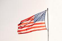 American Flag Over A Blue Sky