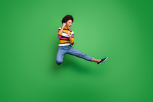 Full Length Photo Of Funny Crazy Afro American Girl Jump Practice Autumn Sportive Kickboxing Kick Legs Fists Fight Enemy Copyspace Wear Shine Beautiful Outfit Isolated Green Color Background