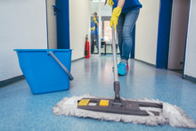Close-up Of Cleaners Moping Th...