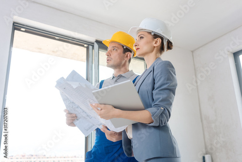 Project owner and construction worker during acceptance Canvas Print