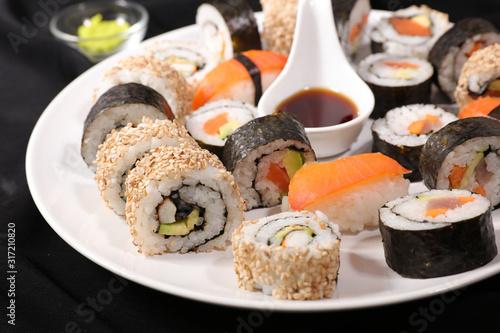 Fototapeta maki roll, sushi and soy sauce assortment obraz