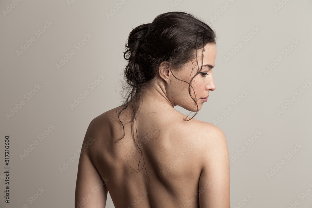 Fototapeta natural beauty concept young woman with wet hair in bun profile and back studio shot