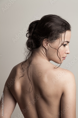 Obraz natural beauty concept young woman with wet hair in bun profile and back studio shot - fototapety do salonu