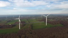 Wind Turbines Along A Highway And Fields In Normandy France Drone Aerial Back Track Early Morning