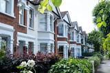 Fototapeta Londyn - Row of brick terraced houses