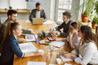 Creating decision. Group of young business professionals having a meeting. Diverse group of coworkers discuss new decisions, plans, results, strategy. Creativity, workplace, business, finance