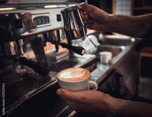 Close up of barista hands preparing cappuccino on espresso machine for customer in coffee shop Wallpaper Mural