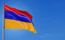 Armenia Flag Waving In The Wind Against Deep Blue Sky. National Theme, International Concept. Copy Space For Text.