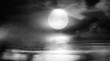 Leinwanddruck Bild - Dramatic black and white background. Cloudy night sky, moonlight, reflection on the pavement. Smoke and fog on a dark street at night.