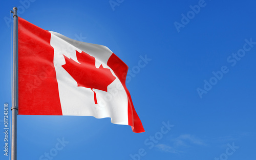 Photo Canada flag waving in the wind against deep blue sky