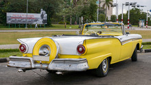 Back Of A Yellow Convertible C...