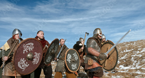 Photo Vikings are go on the offensive. Medieval Reenactment.