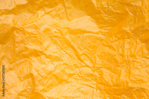 Fotografie, Obraz  Rumpled yellow background. Real texture of the wrapping texture.