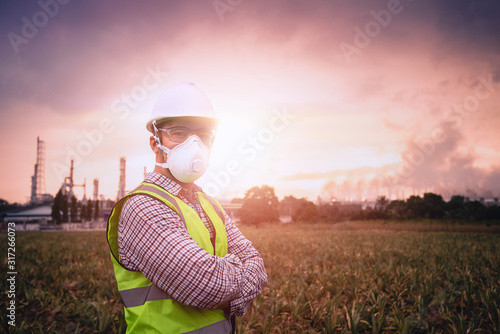 Close up Young engineer, The background is industrial plants, release toxic substances, The background is environmental pollution, Air allergy, Air pollution mask, Beautiful light - fototapety na wymiar