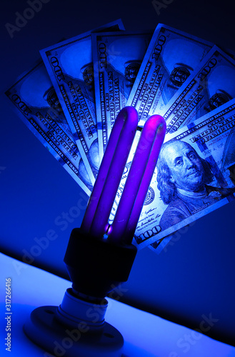 Counterfeit money checking with ultraviolet lamp. Fraud crime. Canvas-taulu