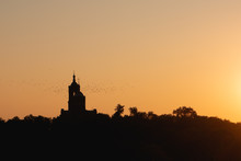 Silhouette Of A Church In A Br...