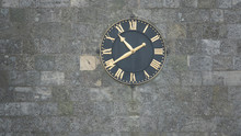 Black Clock With Gold Hands An...