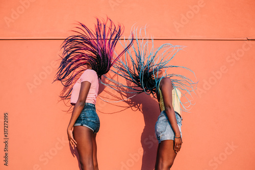 two women sisters dancing moving hair outdoor - 317272095