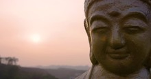 Close Up On The Face Of A Buddha Statue During Beautiful Sunset At Fo Guang Shan Memorial Close To Kaohsiung City, Taiwan, Republic Of China.