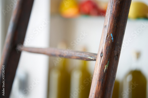 Photo atmospheric detail closeup from a wooden ladder rung with blurred diffuse backgr