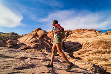 African American Woman Hiking On Rocky Terrain At Red Rock Canyon Park