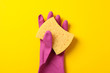 Leinwanddruck Bild - Cleaning glove and sponge on yellow background, space for text
