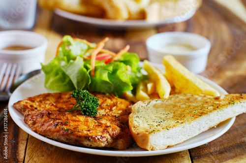 grilled chicken filet with french fries and salad thai style Wallpaper Mural