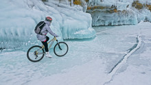 Woman Is Riding Bicycle Near T...