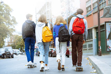 Rear View Of Friends Walking A...