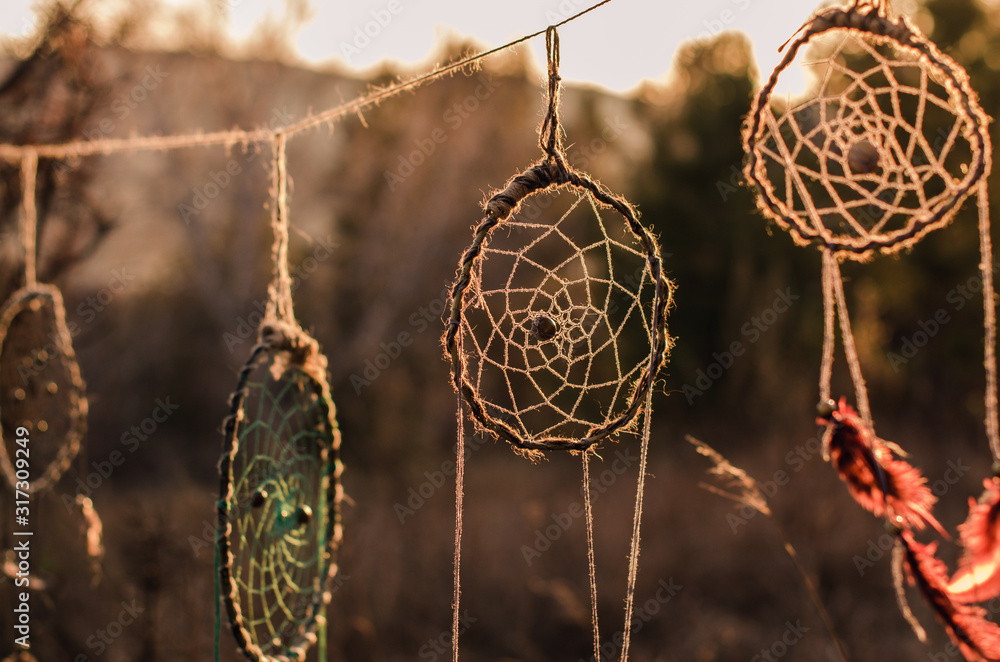 The dream catcher against the background of sunset