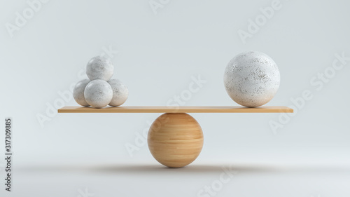 Canvas Print wooden scale balancing one big ball and four small ones