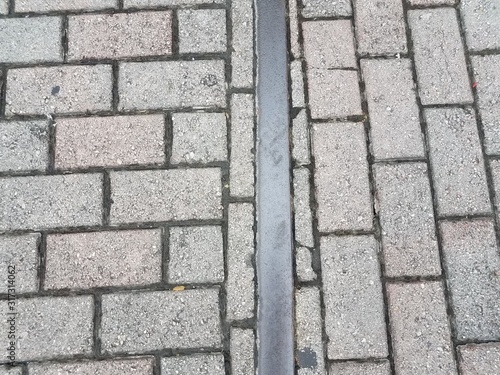 red bricks or ground with metal train track