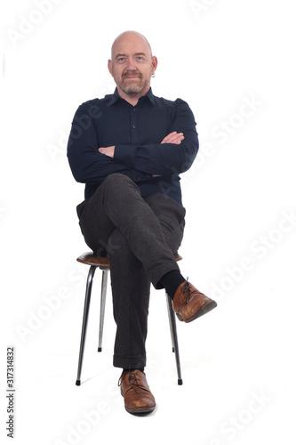 Obraz bald man sitting on white background - fototapety do salonu