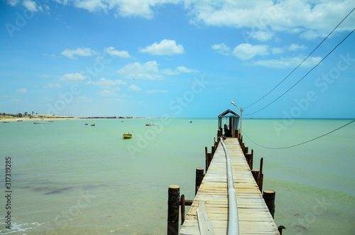 High angle shot of a wooden pier in the turquoise ocean in Columbia Canvas Print