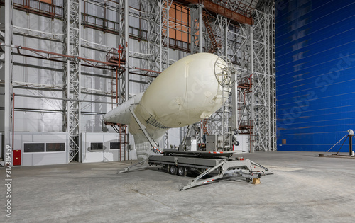 Aerostat on a mobile mooring platform inside an aircraft hangar Wallpaper Mural
