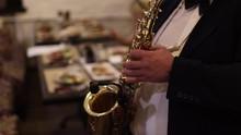 Men Playing Saxophone. Close Up Of Men Playing Saxophone