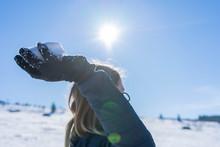 Playful Woman Throwing Snowbal...