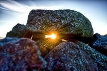 Sunset Through Rocks Flare Sco...