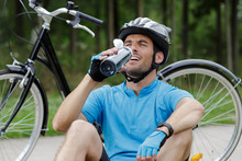 Male Cyclist Stopping To Rest ...