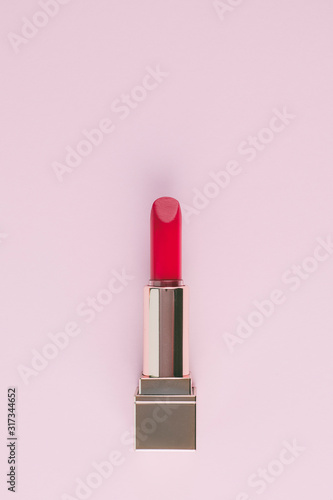 open  pink lipstick isolated on light pink background Wall mural