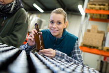 Cheerful Female Brewery Worker...