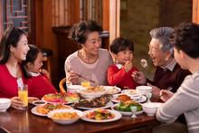 Happy Family Eating Dinner For...