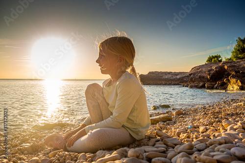 Photo Croatia, Istria, Pula, Cape Kamenjak, blonde girl, sunset scene