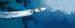 Aerial drone top down ultra wide photo of inflatable speed boat cruising in high speed in deep blue Aegean sea