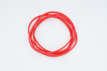 Red Elastic Bands On A White B...