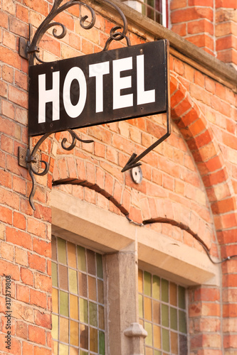 Hotel sign at the entrance of cozy accommodation in European city Canvas Print