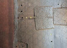 Surface Of An Iron Plate With Some Holes On It.