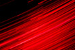 canvas print picture - Futuristic blurred lights holiday monochrome background in saturated red and black, perfect for Christmas, New Year, Valentine, party, technology drop. Horizontal, soft focus